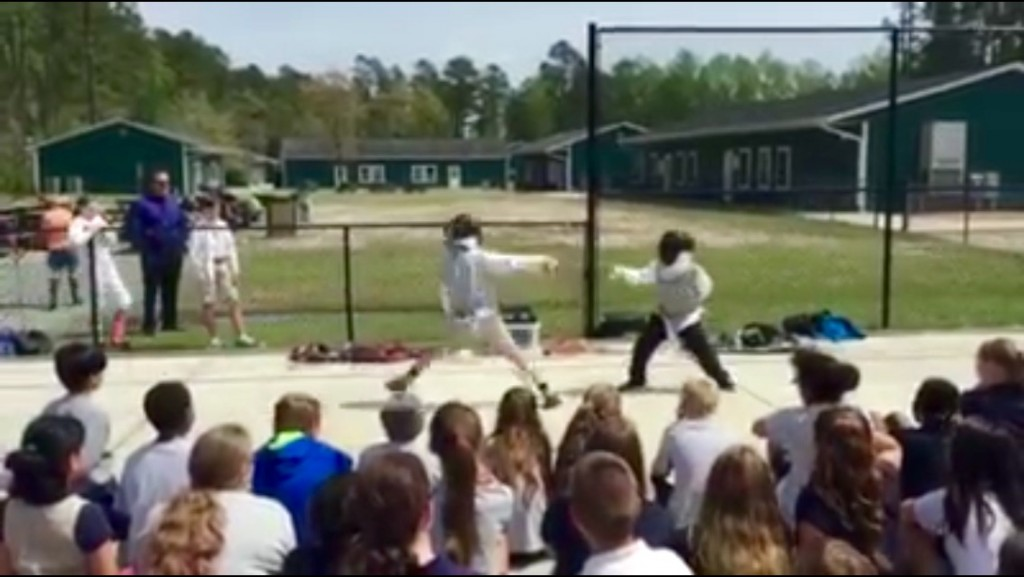 Instructor Gregory Spahr of the Cape Fear Fencing Association leads middle school students in fencing demonstrations.